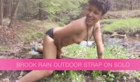 Brook Rain plays in the woods